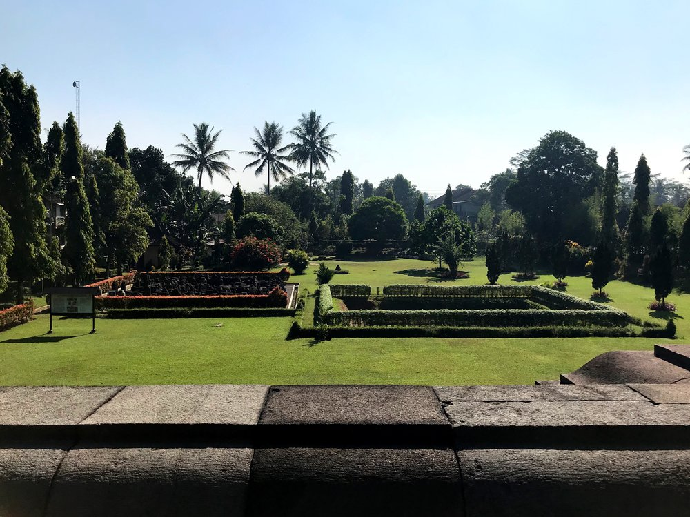 Looking out at the temple grounds from Mendut's raised platform