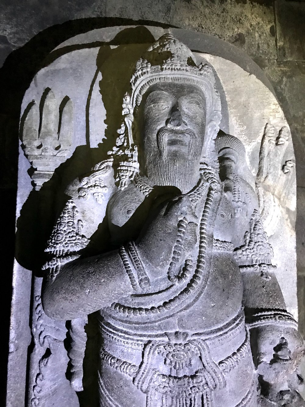 A statue of the dwarf hermit Agastya with his trident