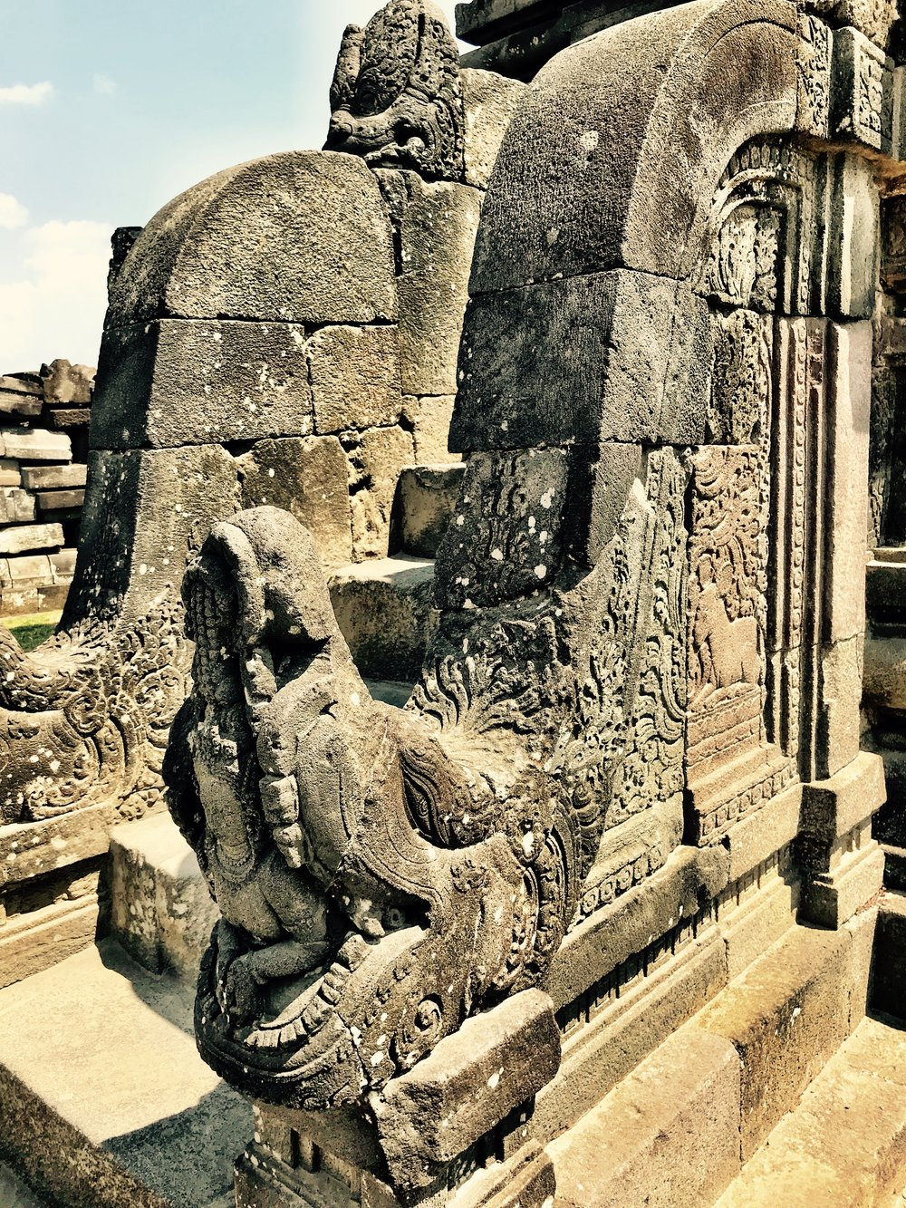 The staircases are carved in the shape of mekara, creatures with other beings coming out of their mouths