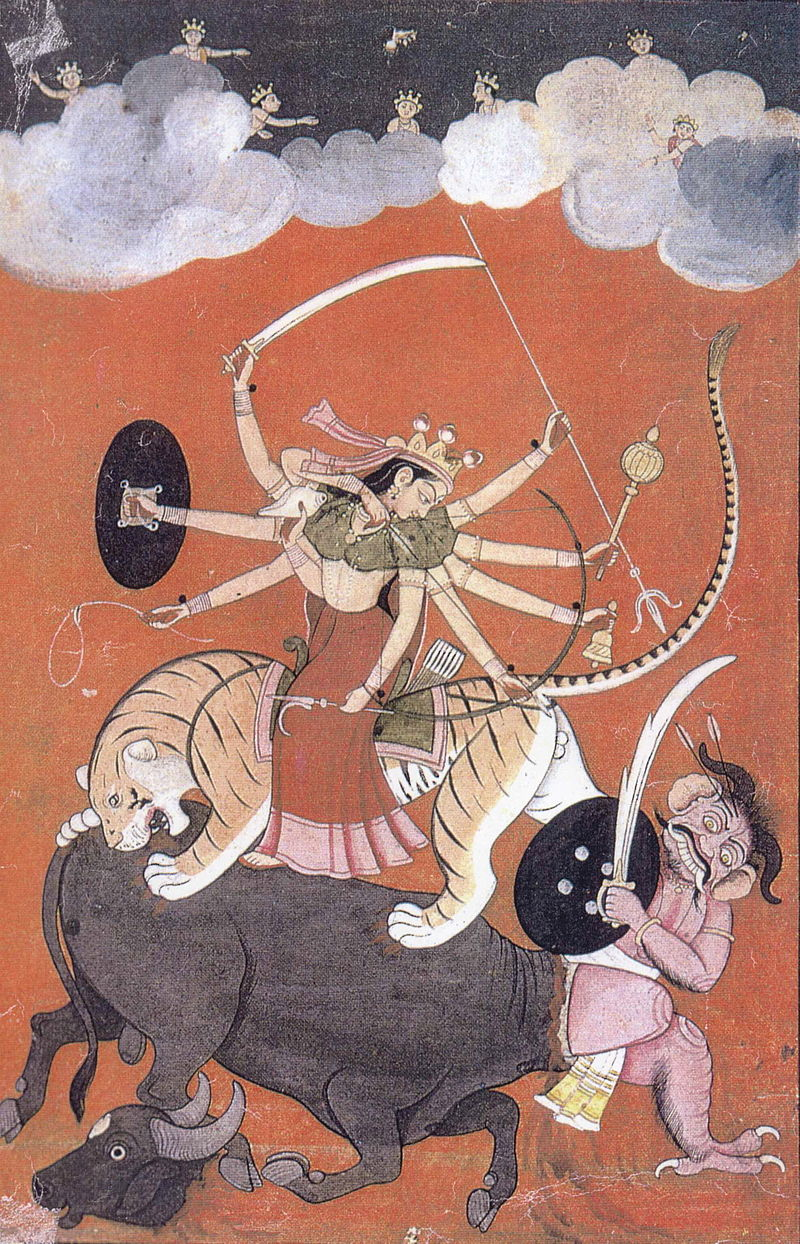 The badass Durga, riding her tiger mount, defeats an evil buffalo demon