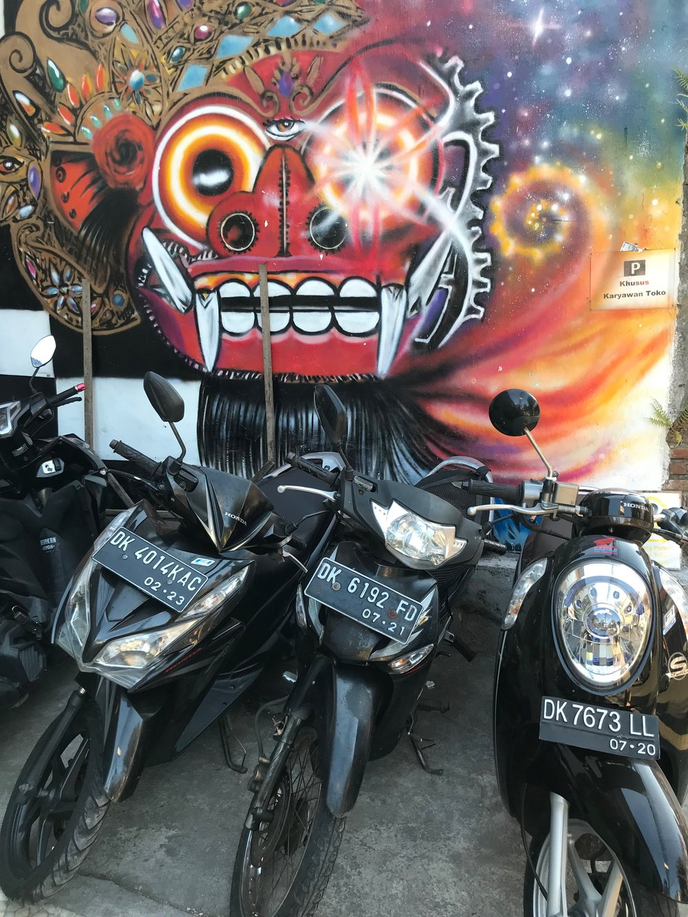 A popular figure on the island, Barong pops up everywhere, such as this street art in Ubud