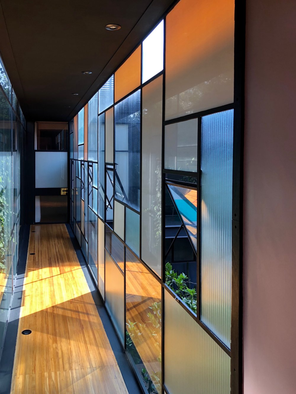 This glass corridor leads from the original house to the new modern wing