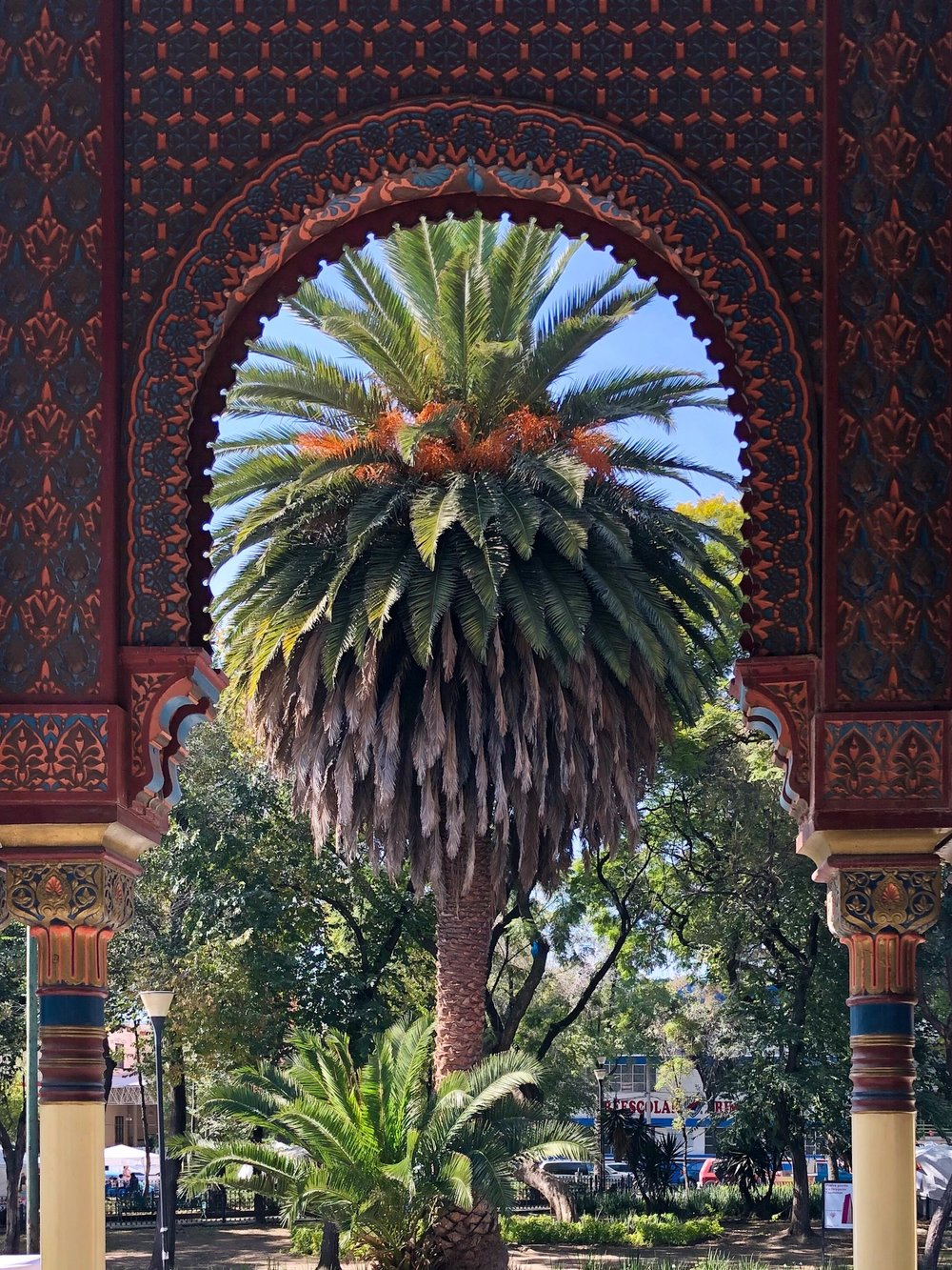 Tropical foliage framed by the pavilion's arch