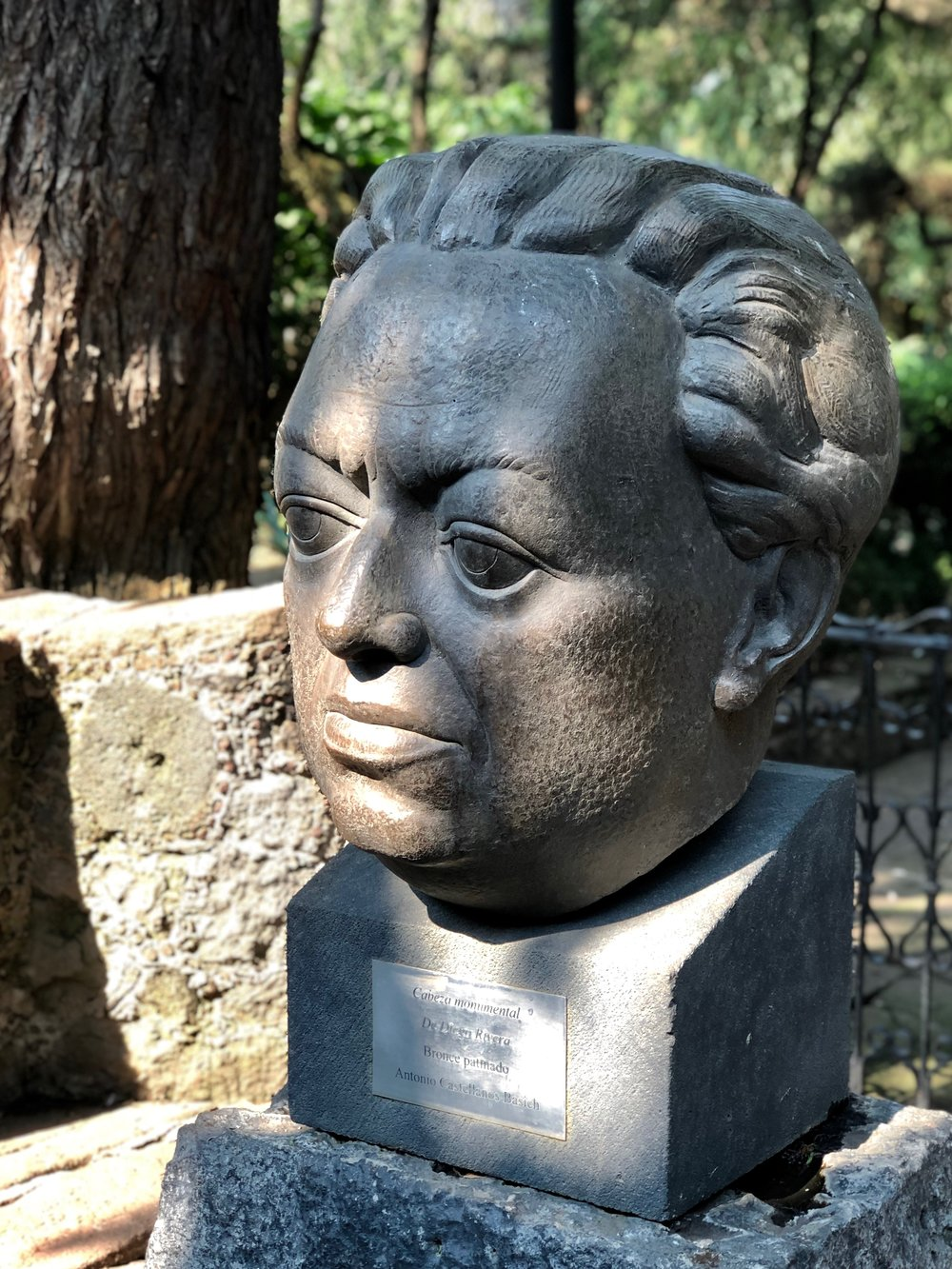 A large bust of Diego sits in the gardens