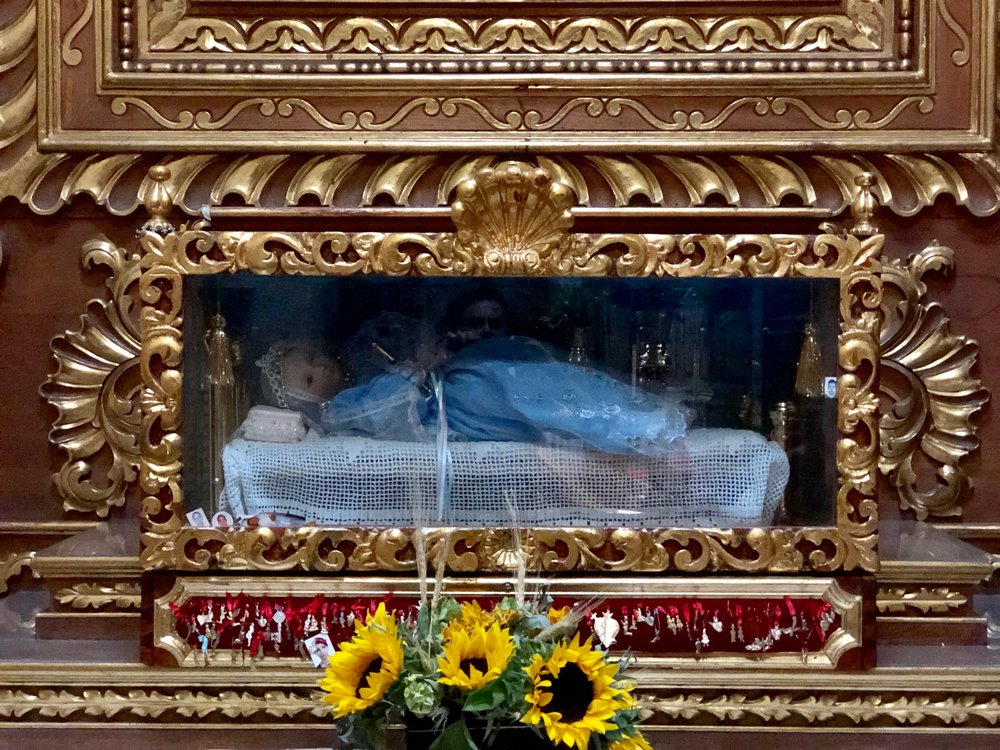 Oh, baby! One of the strange icons to offer devotions to at the Iglesia de Coyoacán