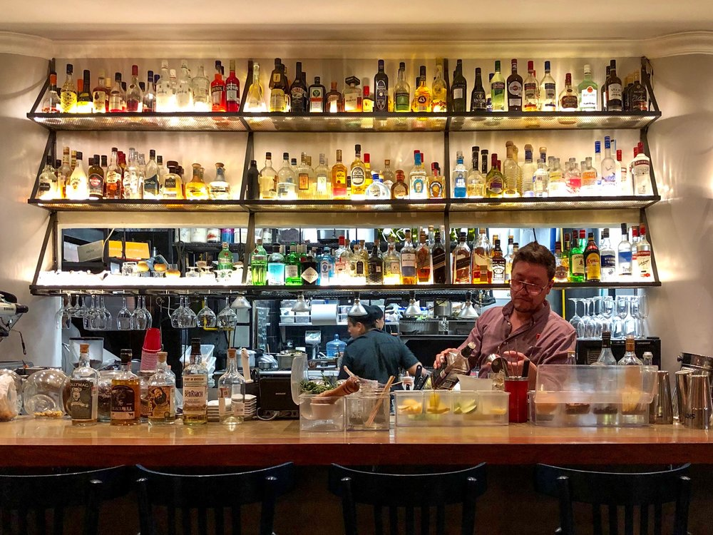 Beyond the bar, you can peek into the kitchen at Bowie