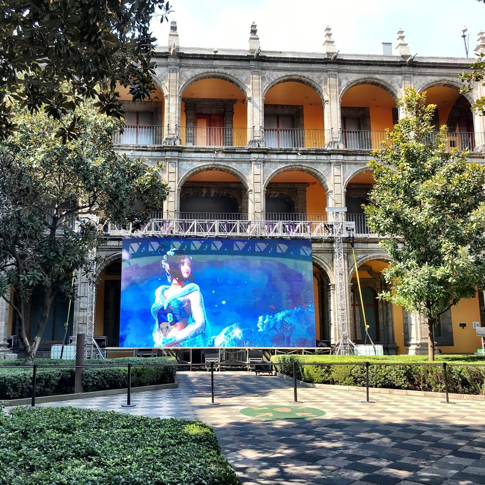 What seemed to be a bizarre fantasy video game ad was playing in the courtyard while we visited