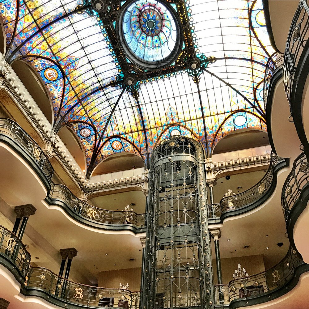 The curving balconies and organic grillwork on the cage elevators make this Art Nouveau gem worth a shot or two