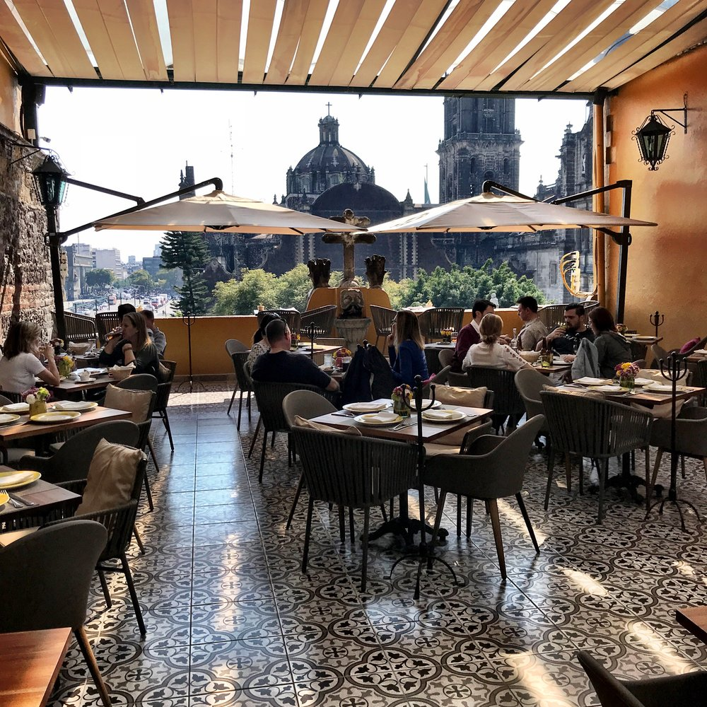 Grab a bite on the rooftop terrace, which overlooks the back of the cathedral
