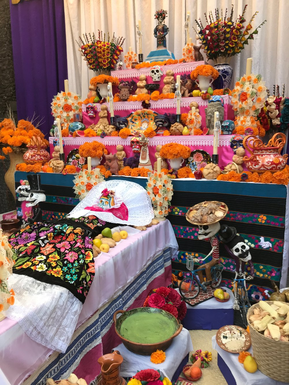 A large ofrenda is set up in the garden