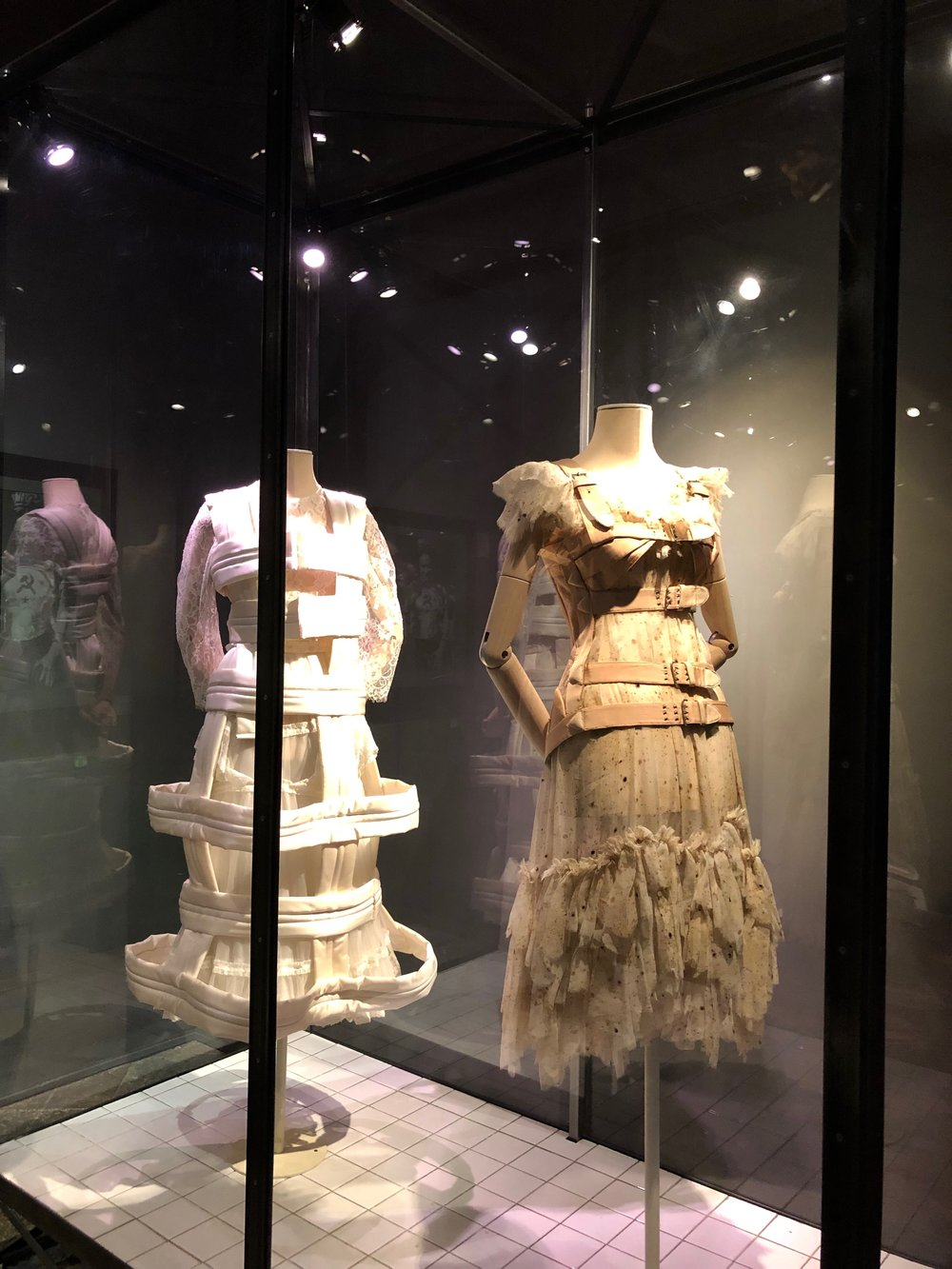 A dress by Comme des Garçons (left) and  The Freckles  by Gaultier