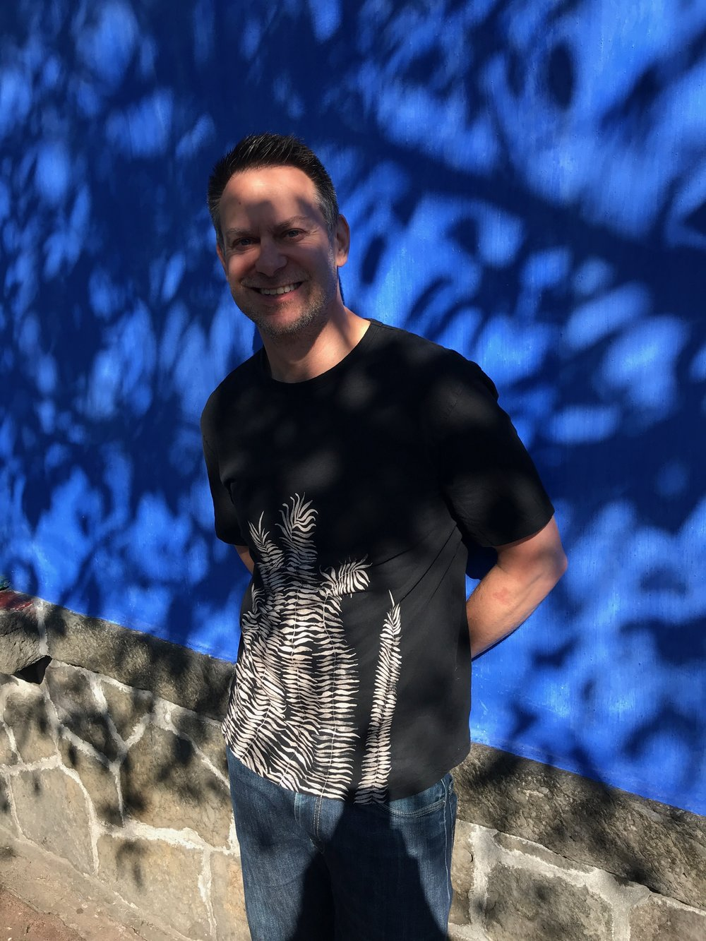 Duke leans on the iconic blue walls of La Casa Azul while we wait to go in