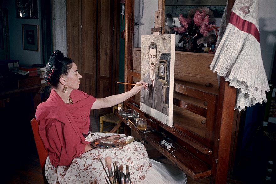 Frida paints  Portrait of My Father , 1952, in her studio. Photo by Gisèle Freund