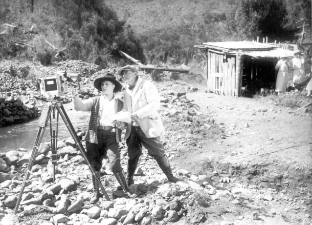 Photo of Louise Lovely directing on set for 'Jewelled Nights' 1925. Image from the National Film and Sound Archive Australia