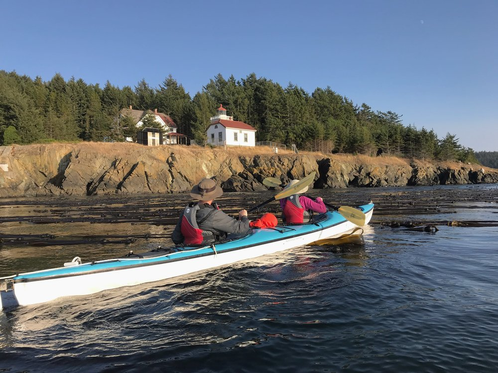 Anacortes Kayak Tours passing by Burrows Island Lighthouse