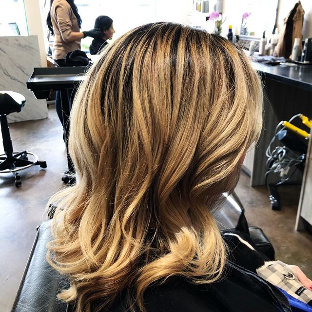 Spring-time means blossoming color!  This client has very dark hair that I gave fabulous, natural yet super bright blondes.  #springblonde #aprilblonde #brightnaturalblonde