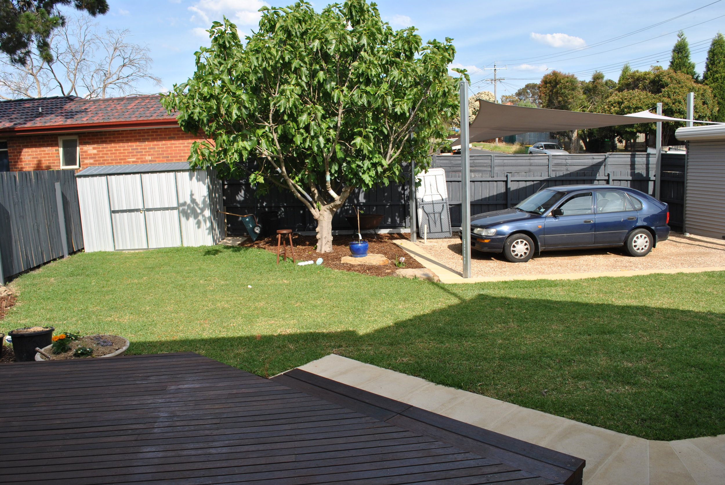 From the deck to the yard. I do love our back yard. We had to do a bit of rejigging to avoid cutting down the fig tree and fit a shed and carport without losing too much space, but now it is a awesome, private, BIG and green yard.