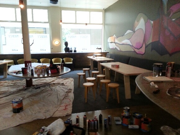 Install in progress. The stools and tables were made by Lee, the artwork was done by Steve Cross.