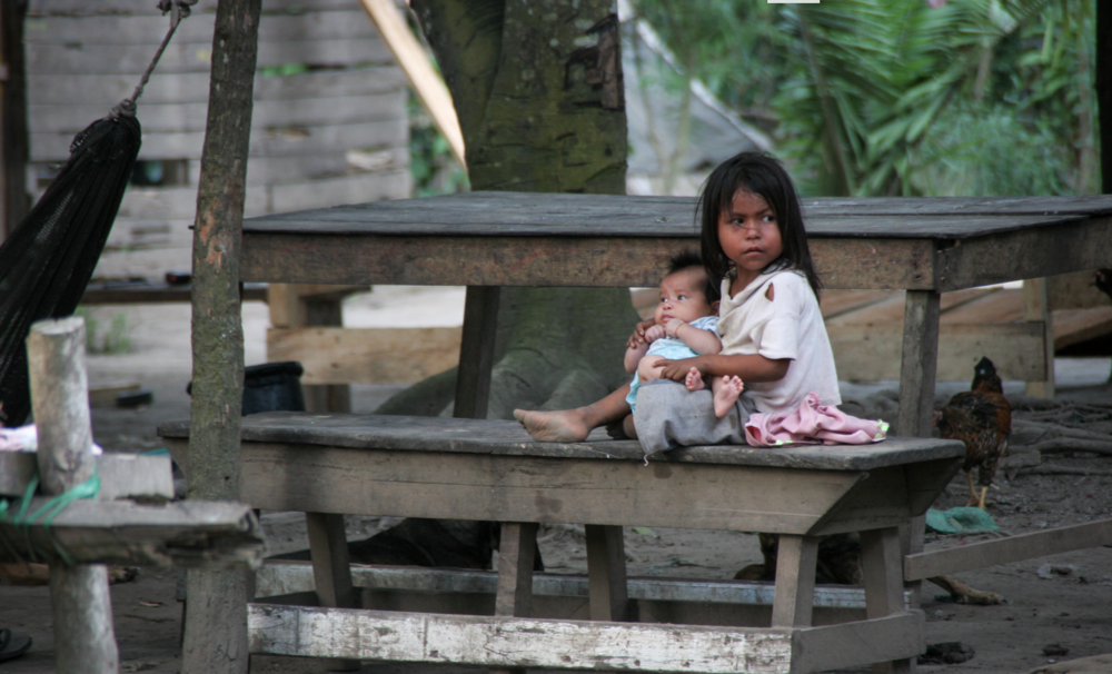 I found this young girl babysitting her little sibling in one of the villages I visited.