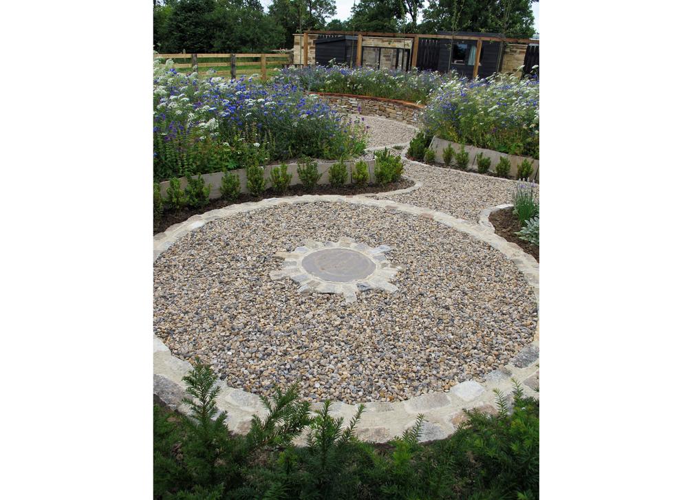 Small circular Area & Yew Hedge