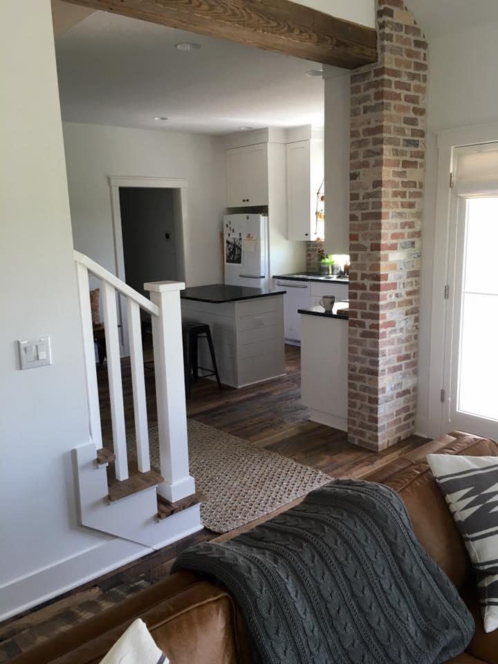Hit & Miss Oak floors with pine header and brick pillar.jpg