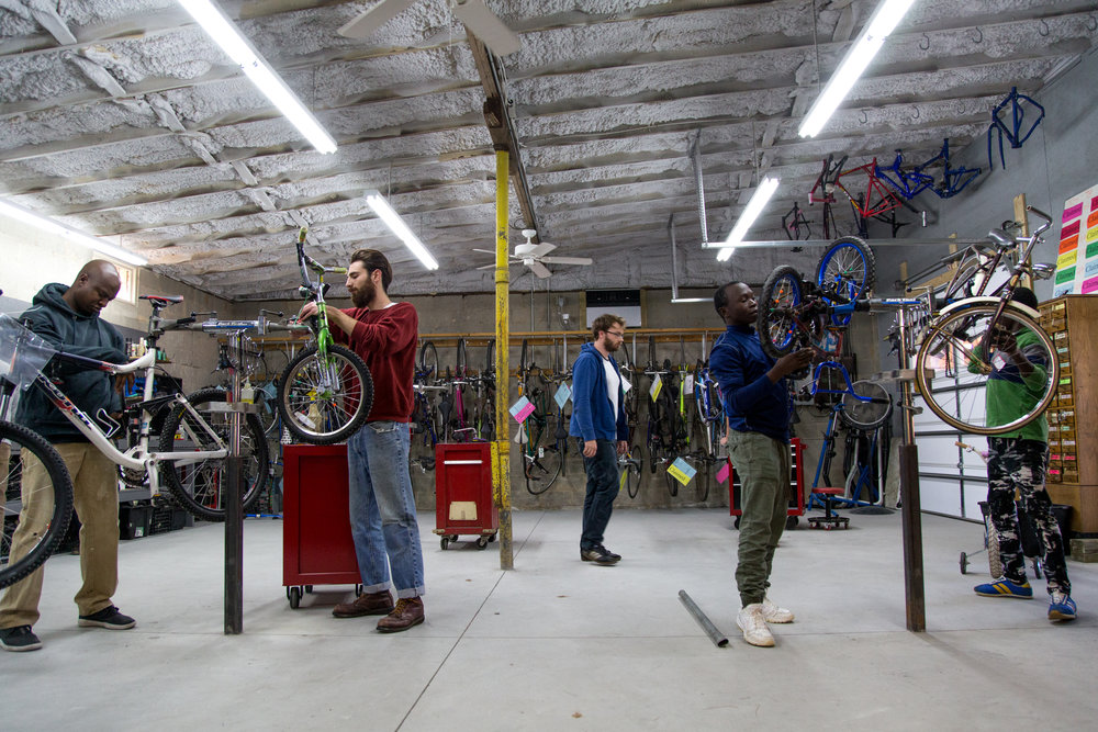 Omar and Hemadi need transportation and can't get a car.  They started working in a Durham Bicycle Co-Op to work for a their bicycle.  After two months, they will both have a way to get around.