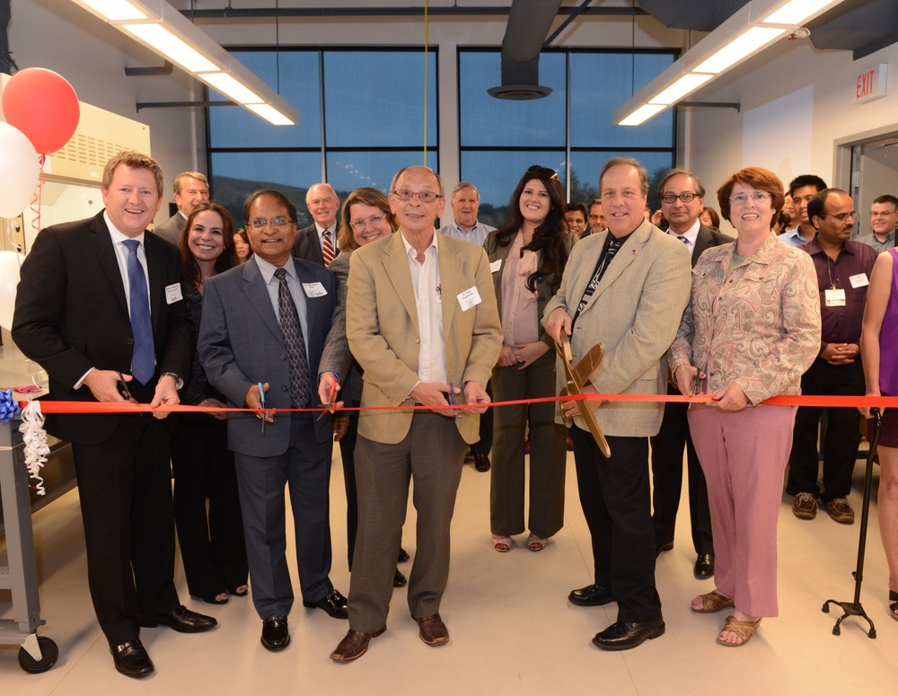 Dr. Gary Gugelchuk, Provost of Western University cuts the ribbon at the opening of the CoE at Cal Poly Pomona.