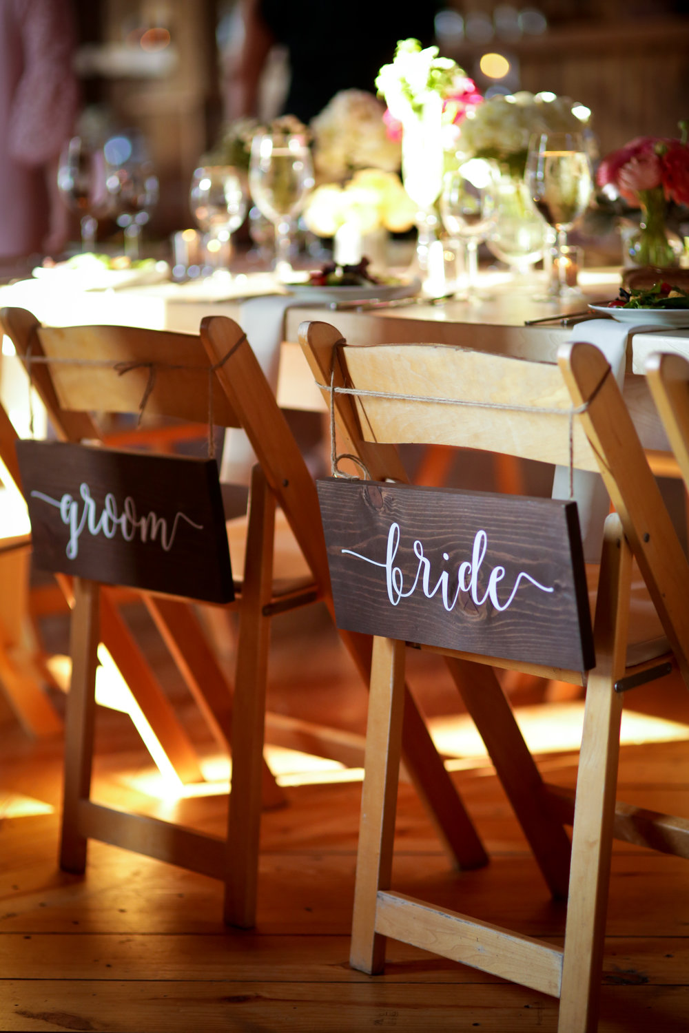 Lovely little detail of the bride and groom chairs.