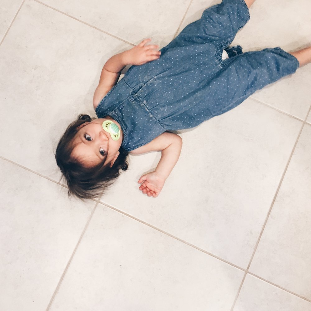 Edie being Edie at eighteen months, laying on the floor and pondering the meaning of life.