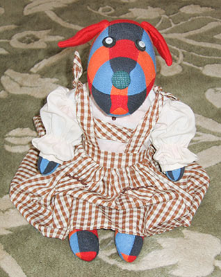 Riina - stuffed sock dog wearing doll dress