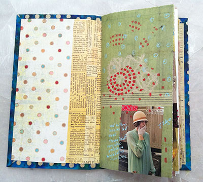 Inside of hardback journal with collaged and journaled page