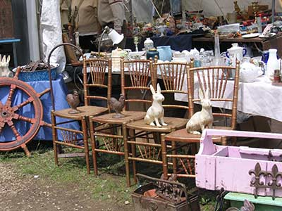 Brimfield antique booth - rabbits and chickens on bamboo style chairs
