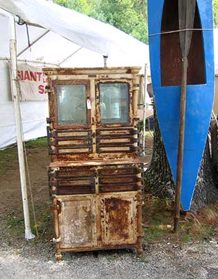 Brimfield - rusty cabinet, blue canoe
