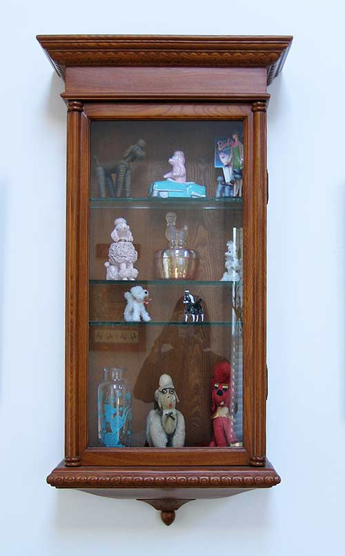 poodle collection in cabinet