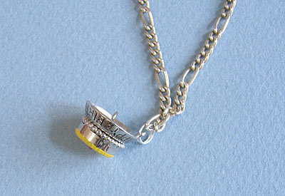 charm attached to necklace chain