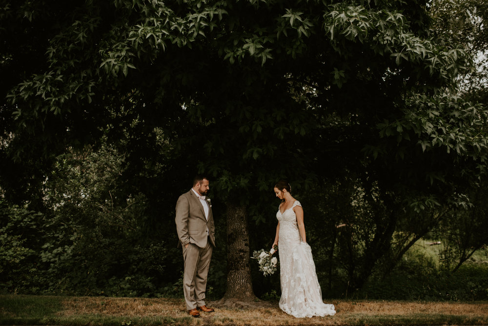 """KIND, PROMPT, FLEXIBLE AND EASY TO WORK WITH""  Kamra was everything we hoped for in a photographer and more, and we can't recommend her enough! I want to get married all over again just so we can have her shoot our wedding one more time. She is incredibly professional, kind, prompt, flexible and easy to work with. Leading up to our wedding, she set aside time to take our calls and answered any and all questions we could think of. She was even willing to substitute her complimentary engagement session, which we didn't need, with a boudoir session (and I couldn't be happier with the photos!). On the day of our wedding, Kamra and her second shooter arrived at our separate locations far before their call times and got started right away. They were both so sweet, attentive, and great at directing our awkward and nervous selves. Kamra was wonderful at balancing getting amazing shots while still letting us have our private moments. We forgot she was there half of the time because of how comfortable she made us feel! Kamra also stayed later than agreed, which we really appreciated. When we got our photos we were completely blown away. Her aesthetic is beyond beautiful and unique, and she captured such cherished moments! She got so many wonderful candid shots of our family and friends as well, and we will be grateful for our photos for a lifetime. If you are contemplating hiring Kamra, look no further! She's your girl! Thank you, thank you, thank you Kamra for the priceless memories you helped us capture!  - Corinna + Dmitry, 2018, Bothell, WA"