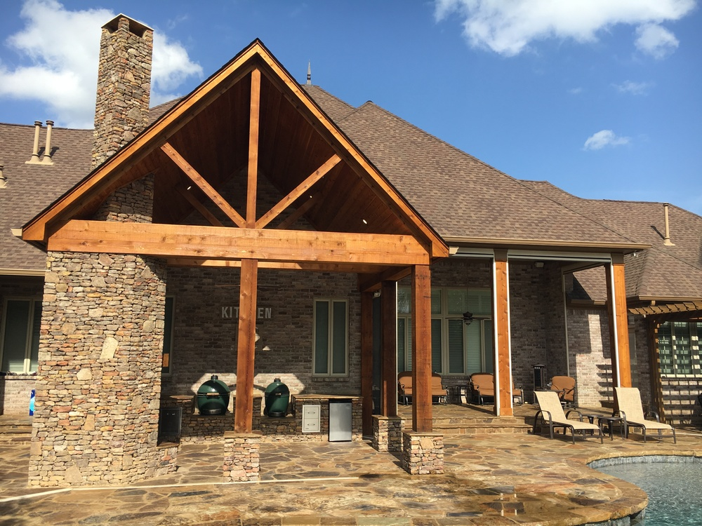 OUTDOOR LIVING  Whether your dream is an outdoor kitchen, pool deck, or fireplace, our goal is for you to feel like you are on vacation each time you step out the back door.
