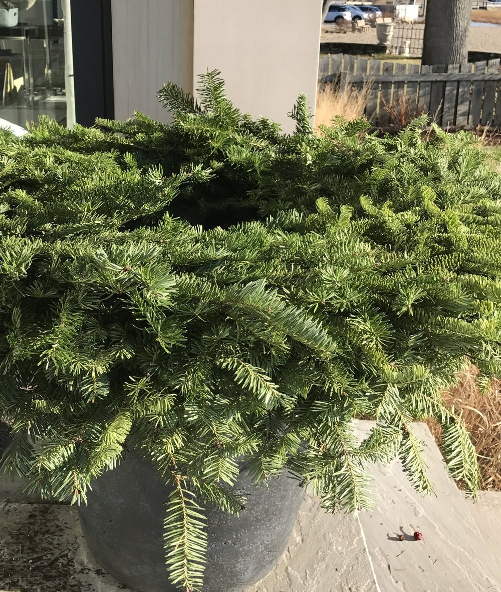 An evergreen wreath forms the base of the construction.