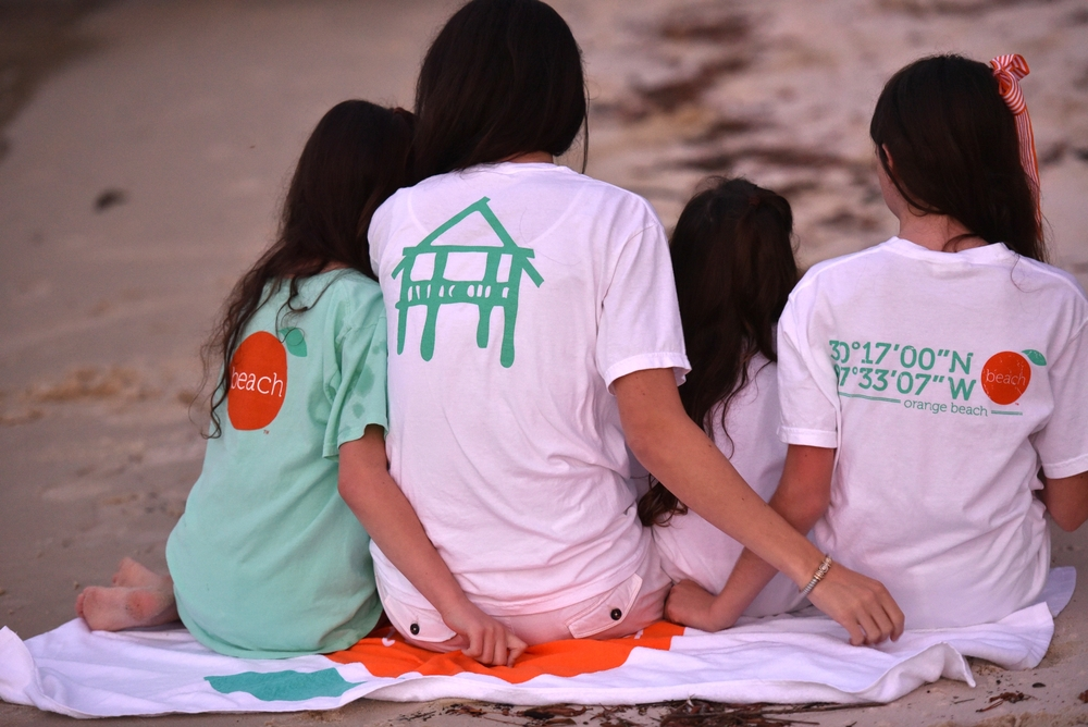 "<p><strong>YOUTH</strong>Our kids tees are 100% super soft pre-washed cotton. And 100% of the ""local"" design supports our local schools.<a href=http://shop.theorangebeachstore.com/youth>SHOP</a></p>"