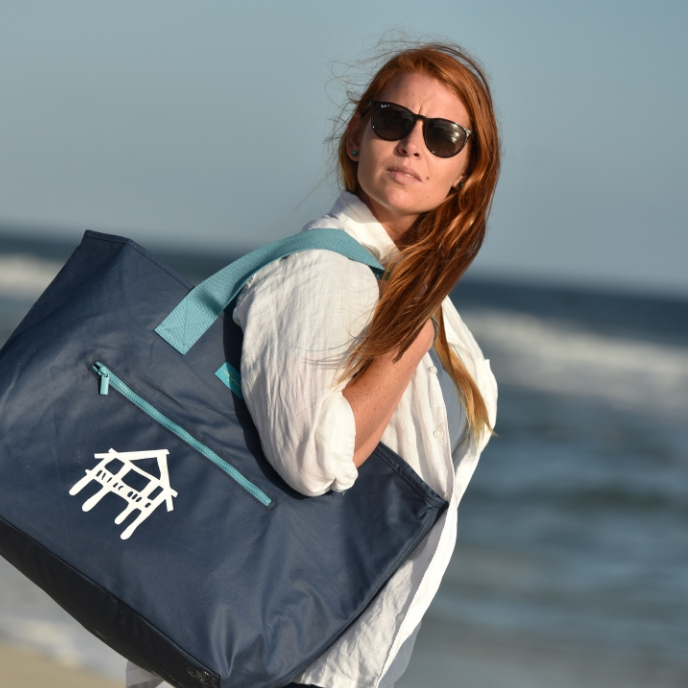 <p><strong>WOMEN</strong>To the beach or just to and fro - the pier bag from MB Greene packs your day.<a href=http://shop.theorangebeachstore.com/women>SHOP</a></p>