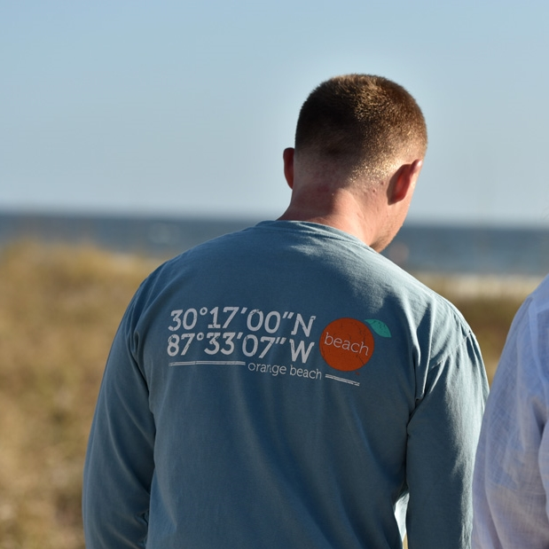 <p><strong>MEN</strong>Our men's long sleeve tee takes you anywhere. Or follow the coordinates to OBA fave Robinson Island.<a href=http://shop.theorangebeachstore.com/men>SHOP</a></p>