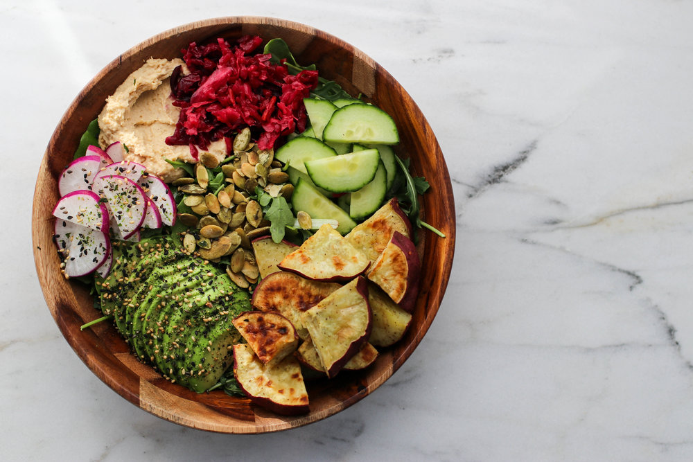 Salad Bowl - I love adding roasted veggies to my salads in the wintertime. This is arugula, roasted sweet potatoes, cucumber, radish, avocado, beet kraut, hummus, pumpkin seeds, furikake, and lemon vinaigrette. Make this to-go by layering in a Tupperware or Mason jar. Dressing on the bottom, followed by veggies, then avocado, nuts/seeds, and arugula. Pack the hummus and kraut separate.