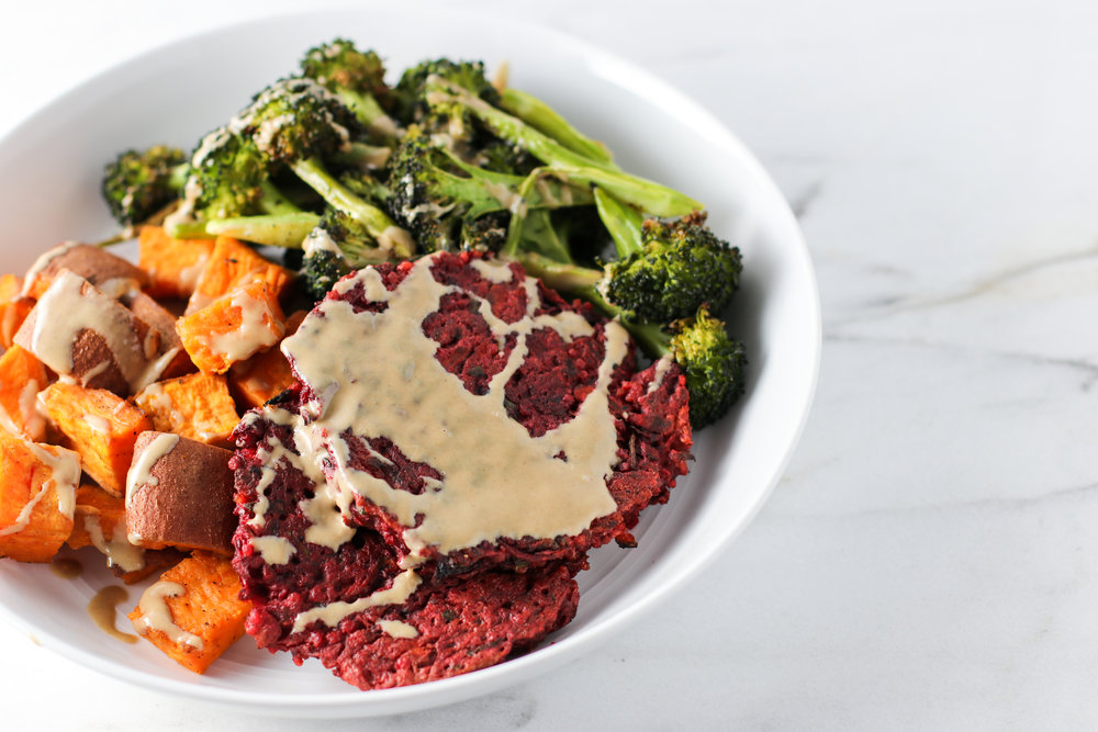 Beetroot Burgers with Roasted Broccoli and Sweet Potatoes - I had a similar dinner to this twice. I like to roast broccoli the day I eat it as it only takes 15 minutes in the oven. Then, reheat the burgers and sweet potatoes in the toaster oven while the broccoli roasts. Top with a good drizzle of tahini. (The other night I made kale instead of the broccoli.)