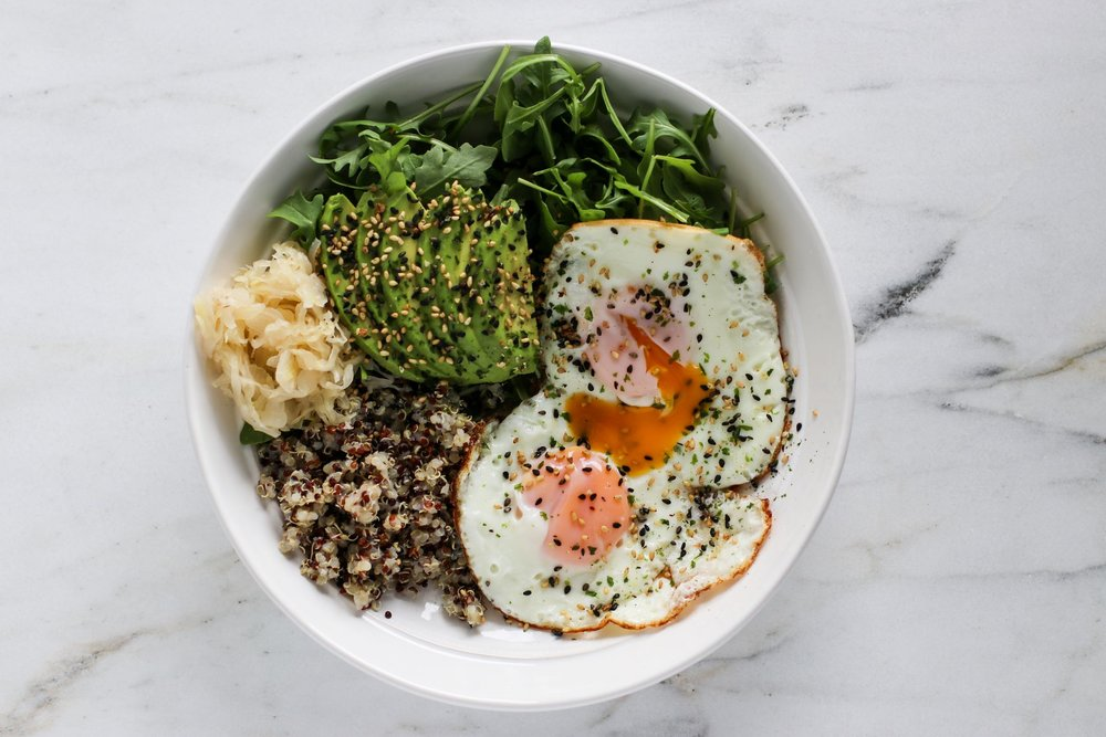 Salad Bowl #1 - I'm calling this a salad bowl over a nourish bowl because I had it for lunch. But it's really either - the line between them is fine! Quinoa, avocado, two coconut oil fried eggs, arugula, sauerkraut, and a gomasio topping. Protein, fiber, healthy fats, and probiotics = a perfectly filling lunch.