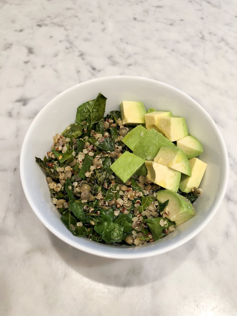 Quinoa, Lentils, and Kale - This is my 5-minute meal prep dinner for the win.Quickly wilt pre-chopped kale with olive oil and red pepper flakes. Stir in lentils and quinoa, then cook until warmed through. Add a little avocado for healthy fats and you're set!