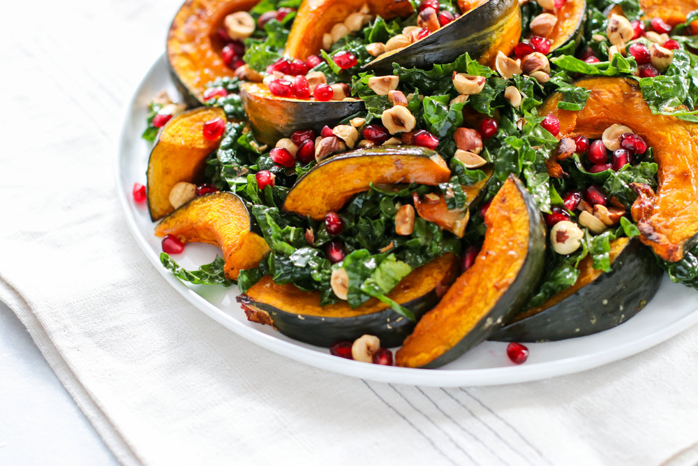 Winter Squash Salad with Massaged Kale, Toasted Hazelnuts, and Pomegranate