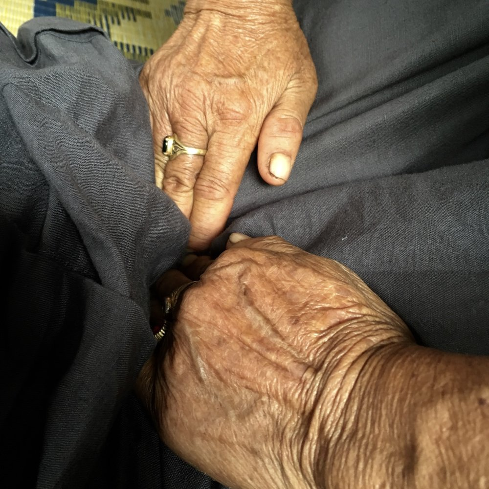 The beautiful hands of a midwife in her 70s demonstrating a deep prenatal technique in a small village in northern Thailand.