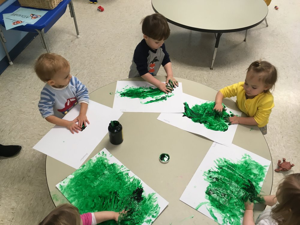 Finger painting with green paint!