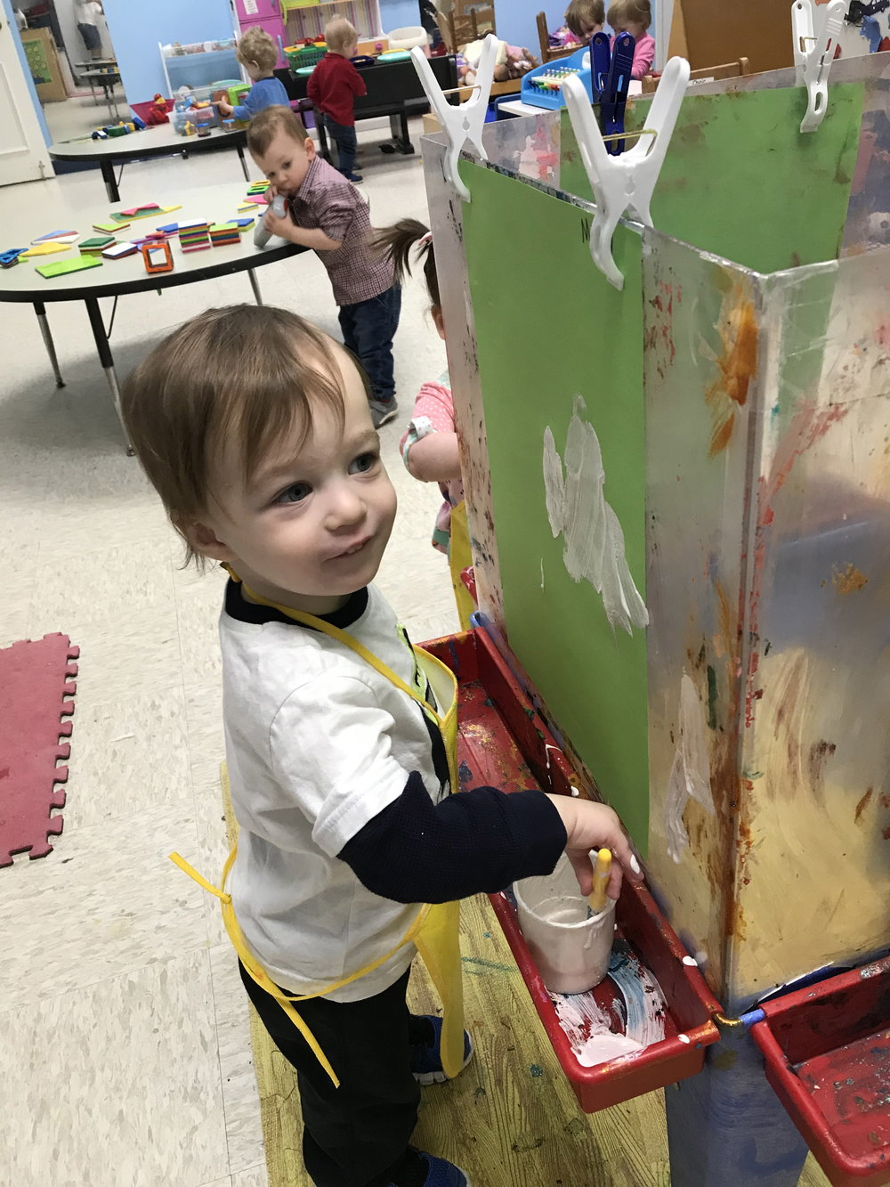 We love to easel paint - this is great for prewriting and movements across the body.