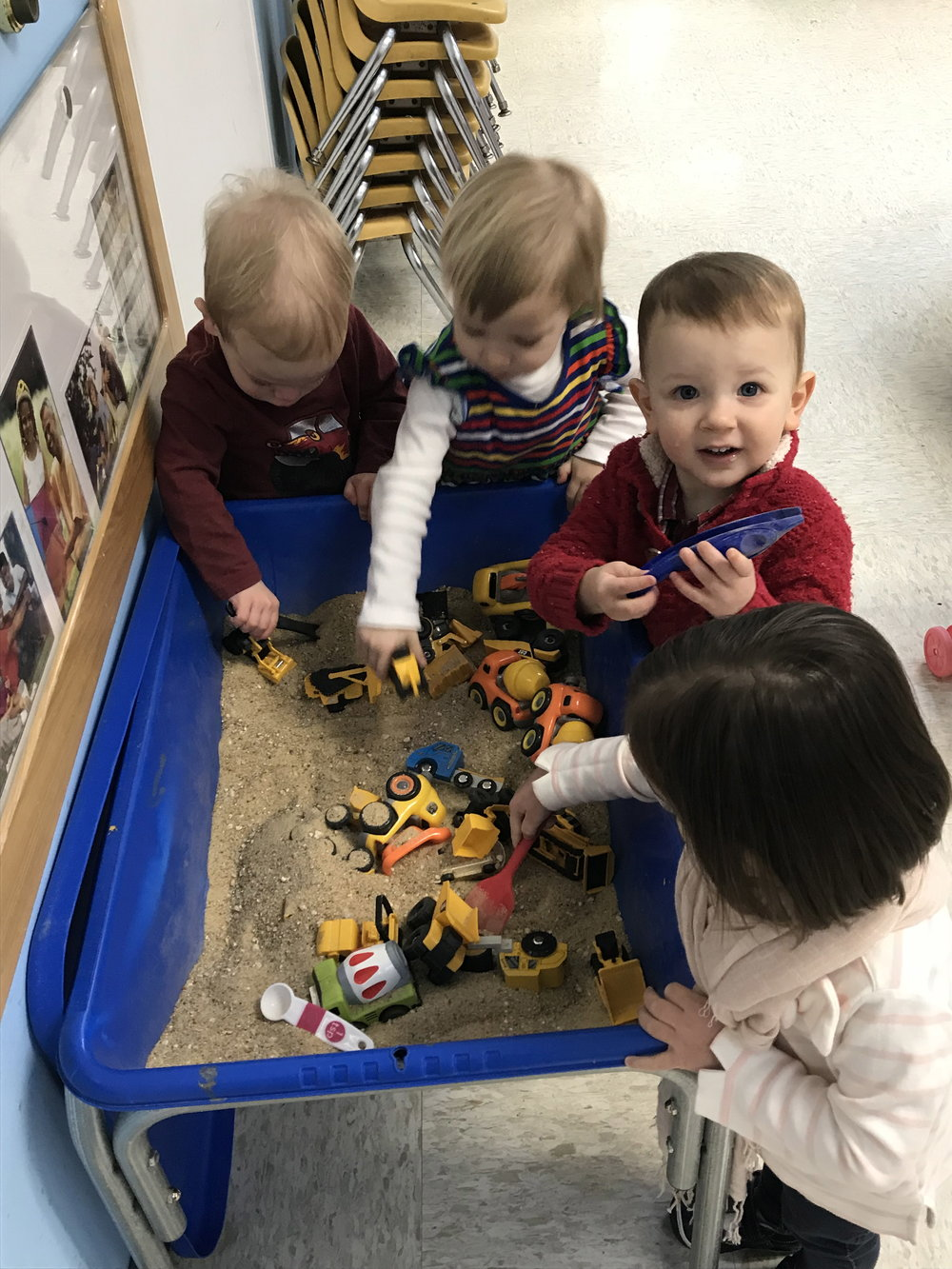 Construction trucks in the sensory table.
